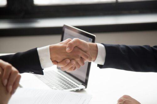 Businessman handshaking businesswoman showing respect, closeup v